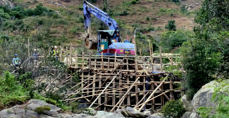 Bamboo bridge access for drill pad formation