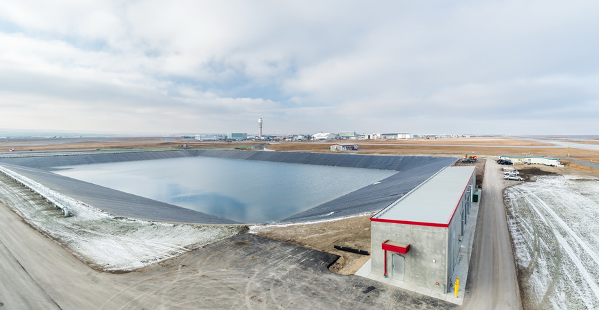 Glycol-contaminated stormwater retention pond and blower building at Calgary International Airport